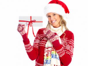 Happy woman with christmas present isolated over white background.